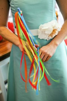 colorful ribbon wand. Not satin ribbon. cheap with wedding colors instead of confetti ect as you walk back down the aisle