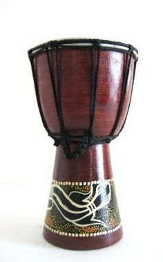 "Djembe Drum African Bongo Percussion Instrument - Large 11"" x 7"" - Handpainted by World Bazaar Imports. $29.99. The resonating sound of the Djembe has made it a popular instrument amoung everyone.  Made from a block of hardwood, this traditional percussion instrument features popular tribal motifs in contrasting colors.  The Djembe originated in Benin where it is used for voodoo rites and has now been introduced into neighboring countries.  Features a genuine goatskin drum ..."