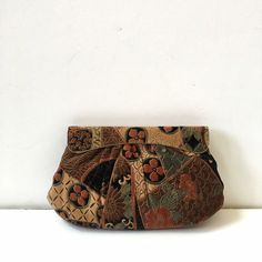 """Vintage Floral Clutch Velour floral exterior, gold tone hardware with snap closure. Lovely purple interior. Optional shoulder strap. Approximate measurements are 10.5"""" long, 7"""" tall, 1.5"""" wide. Boutique Bags Clutches & Wristlets"""