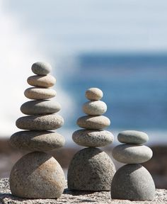 Natural pebbles balanced on a round stones create traditional Cairns suitable for any garden space. Appropriate for indoor or outdoor use