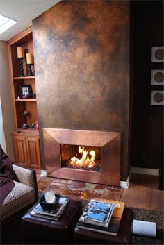 """Rust-Copper Fireplace Surround, I love the """"leather look"""" on the walls! I want that."""