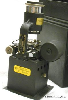 This is a Spencer Filmslide Attachment for a Magic Lantern.