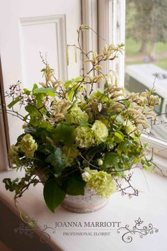 Green rustic table arrangement. Rustic green wedding theme perfect for summer and spring wedding theme.