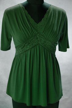 Love this shade of green on this empire waist top that is available up to size 5X (60 inch bust).  www.ebay.ie