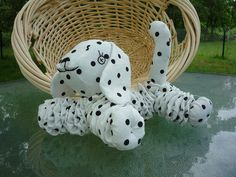Yo Yo Puppy    Wonderful item for a gift    Child Friendly.      This is a handmade yo yo Puppy made from my handmade yo yo quilt pieces.    This puppy is made with handmade yo yos. A white fabric with black dot print went into making this puppy. Cute little Dalmation puppy. My yo yo animals are made from a cotton or cotton blend material. Everything is hand done. I hand embroidered the face on this adorable little puppy dog. There is no bells or buttons to cause a choke hazzard. Each little…