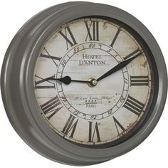 Full of French country flair, this metal wall clock features a traditional face which looks right at home in your kitchen or bathroom.