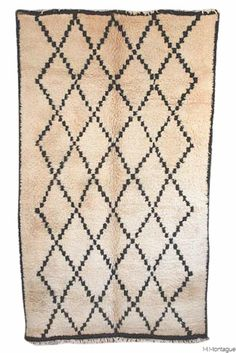 Looking to add some Moroccan style to your decor with a Beni Ouarain rug? This one is for you! The most chic and cozy neutral in the famous diamond pattern. Very fresh and the perfect size! Available at the Maryam Montague online Souk!  http://www.mmontague.com/carpets-index-new/qv8f2oop8y83jvbiba9inmpiyyvald
