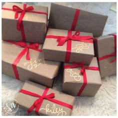Love this wrapping! So easy to do (and cheap) for everyone. Brown wrapping paper, gold sharpie, blue ribbon. I now use this for everyday gifts too and just use a different bow color.