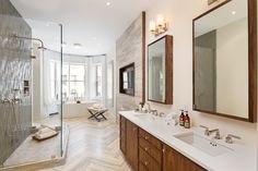 Glen Jackson @TOPREALTORNYC $12,950,000 FOR SALE 6 beds, 5 baths master bathroom features ocean blue travertine flooring in a chevron pattern, and the stone is echoed in the shower and on the wall. Rooms throughout the townhouse feature high ceilings, some as high as 14 feet.