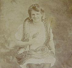 Snake Charmer Emma Pearley with Giant Python, J.J. Ginther Buffalo photographer. (c. 1885)