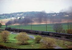"""One of the great Reading Class T-1s romps through the Lebanon Valley in this scene from a slide scanned from the collection of the late Hen Westenberger. This appears to be the """"Reading Ramble"""" excursion from Wayne Junction (Philadelphia) to Gettysburg, based on the 5-62 date of the slide. (The Friday, April 27th edition of the """"Gettysburg Times"""" mentions the """"Reading Ramble"""" coming to town """"this Sunday."""") The locomotive in the photo may possibly be the 2100, which was replaced with the…"""