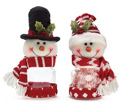 """#burtonandburton Snowman plush with octagon-shaped acrylic candy holders. One snowman with black top hat and red/white striped scarf. One snowman with red knit hat and red/white chevron scarf. Red fabric on the bottom of both.<br><br>9""""H X 3 1/2""""W X 3 1/2""""D X 2 1/2""""Opening<br>3 assortments of 2."""