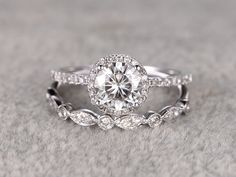 Start your happily ever after on a sweet note with this moissanite leaf engagement ring set from Camellia Jewelry. Scrupulously handmade in fine detail, it is a unique wedding ring set that will show her how much you care without breaking the bank. Bridal Ring Sets, Bridal Rings, Wedding Jewelry, Titanium Wedding Rings, Gold Wedding Rings, Engagement Ring Settings, Engagement Rings, Bridesmaid Jewelry Sets, White Gold Rings