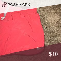 Coral Nike shorts. Shorts in great shape. Initials are written on the inside but not noticeable when worn. Longer than typical Nike running shorts. Very soft. Nike Shorts