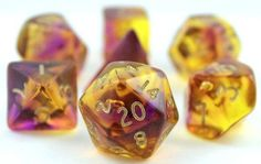 Firefly Dice (Purple and Yellow) on sale now at Dark Elf Dice. Firefly dice are cast in a breathtaking blend of translucent colors. RPG dice set includes d4, d6, d8, d%, d10, d20.