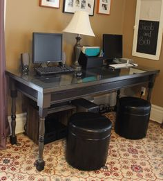 Desk made with pieces from the Detroit Architectural Salvage Yard.  5 panel door for the top, old porch spindles, trim, and a glass top.