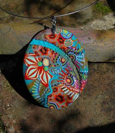 Polymer clay pendant by Dumauvobleu