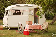 This is what i want when I retire along with a F150 pick up truck .... we could travel any where Retro Caravan, Shabby Chic Caravan, Caravan Hire, Retro Campers, Camper Trailers, Vintage Campers, Tiny Trailers, Classic Trailers, Caravan Decor