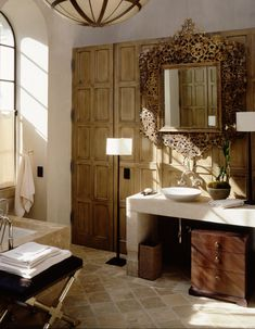 """""""The clients had met and fallen in love in Italy, and that was their direction as a place to start at their Nashville house. But by the time we got to the bathroom, we wanted to pare it back to its most basic elements,"""" says Booth. """"We went with a strictly plaster wall that rolls up onto the ceiling into a barrel vault, which has this calming effect. There are no moldings or baseboard trim—everything is made of plaster."""" The mirrors were a chance to bring ev..."""