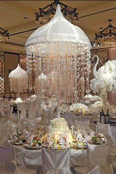 Preston Bailey designed flowered canopy hovers over each table and swan sculptures made of white flowers decorate the space,