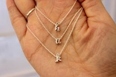 Cursive letter necklace, tiny silver initial necklace, dainty lowercase initial necklace, birthday bridesmaid gift, toddler necklace by GreatJewelry4All on Etsy https://www.etsy.com/listing/254782889/cursive-letter-necklace-tiny-silver