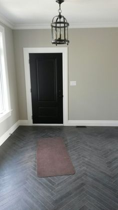 "Benjamin moore ""revere pewter"" walls with ""onyx"" door... And that gray wood herringbone pattern floor"