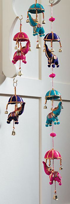 Can get similar at world market-would want on sides of curtains to blow in wind with window open :) String of 3 Indian elephants with umbrellas
