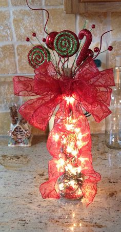 Light up wine bottle! Christmas lights inside the bottle, along with some glitter sticks for that extra sparkle! No drilling needed! Just cut towards the end of the cork and have the cord come out from there! Much easier! And safer for those of us who do not know How to use power tools!