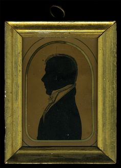 """Rare three-quarter body profile silhouettes, young lady holding a book and man with a watercolor enhanced collar, both in an arched white and gilded mat, """"Grandfather of Mary Heald (Bennett) on her father's side and Elizabeth Howard Heald, Grandmother of Mary Heald (Bennett) on her father's side"""", small tears at top of both, purchased at Cottone Auction, Mt. Morris, NY, February 28, 2004, $1120, 4 1/4″ x 3 1/4″,"""