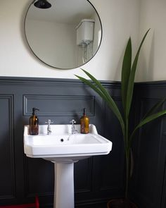 @ahousebythetrees Instagram downstairs toilet, bathroom, panelled bathroom, panelling, wainscotting, Farrow and Ball Downpipe, round mirror, victorian high cistern toilet, Amber glass