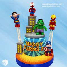 Avengers and Justice League Superheroes Cake. Marvel and DC superheroes suit up and unite for a little boy's birthday celebration | Cakes by The Regali Kitchen