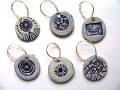 'Tis the season! Ceramic ornaments made using handmade original stamps.