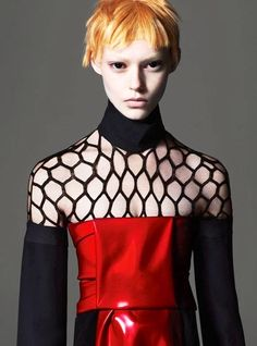 I like the fishnet top and the sleeves. Maybe good for dance practice or maybe even a costume.. www.fashion.net