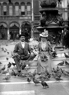 Well Dressed Couple--Complete with Fancy Hats Posing with Pigeons #Venice #fancyhats