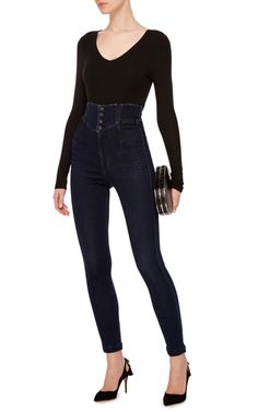 Since 2003 **Citizens of Humanity** has been chief in creating cutting edge denim. Their expertise is evident in these super high waist Tiana jeans in a dark wash that stops just below the bust.