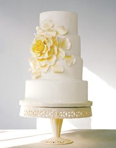 wedding cake with big flower on side