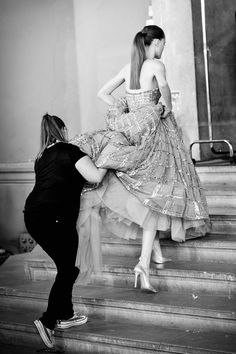 Pin for Later: If You Thought Catwalk Couture Looked Amazing, Wait Until You Go Backstage  A model is helped up the steps in a voluminous Zuhair Murad gown.