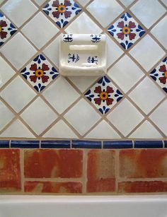 Would like to do a mexican tile motif in the master bath w/a stand-up shower.