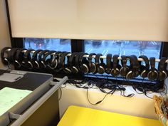 Great way to store class set if headphones. Use a tension rod!
