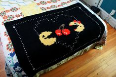 Pac-Man and Ms. Pac-Man In Love Throw. via Etsy.