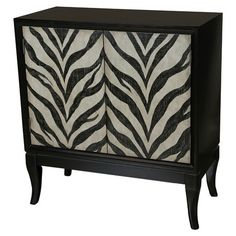 Display a vase of fresh blooms in your foyer or stow table linens in the dining room with this zebra-striped cabinet, showcasing 2 doors opening to a bold re...