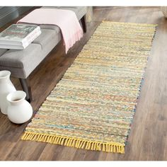 Recall the simple charm of American textile art with this 2'3 x 8' rug from Safavieh's Rag Rug Collection. Its beauty is highlighted with variegated vibrant trendy colors for a uniquely one of a kind