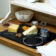 Handpickeds slate cheese board keeps it just cool enough, and you can write the names of the cheeses on with the accompanying stick of chalk. for-the-home Cooking Equipment, Cooking Tools, Slate Cheese Board, Come Dine With Me, Cheese Lover, Home Goods Decor, Simple Gifts, Perfect Food, Food Hacks