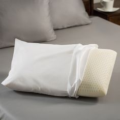 Switch pillows and use this hypoallergenic foam pillow, and you'll enjoy more restful sleep. The latex pillow is filled with a soft foam that won't irritate allergies and resists growth of bacteria, mold, or mildew. The cover removes for easy cleaning.