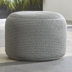 This can double as a side table (with a tray for drinks/snacks) as well as additional seating.   Grey Outdoor Pouf