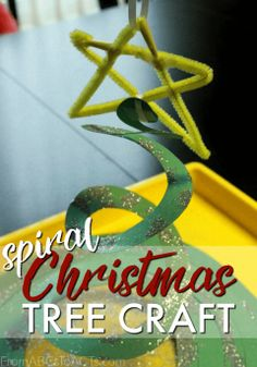 Add a little extra holiday cheer to your home with this super easy spiral Christmas tree craft for kids!