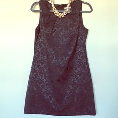 "Rich black brocade patterned dress Forever 21 dress with a rich brocade pattern and fabric-covered buttons in back. Size M. Only minor wear, wore 1-2 times. Hits a little above the knee on me (5'2""), so may be more of a minidress on a taller person. Necklace not included. Forever 21 Dresses"