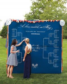 """The tournament-bracket seating chart, printed on vinyl and hung from a pipe-and-drape frame, asked guests to """"please be 'seeded.'"""""""