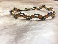 This beautiful bronze tila bracelet is handmade using a woven technique. Materials:bronze tila beads Measure: 7 inch