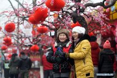 People take selfie at the 32nd Longtanhu temple fair in Beijing, China, February 21, 2015. Chinese people nationwide attend various festivities on the fourth day of this year's Spring Festival holiday
